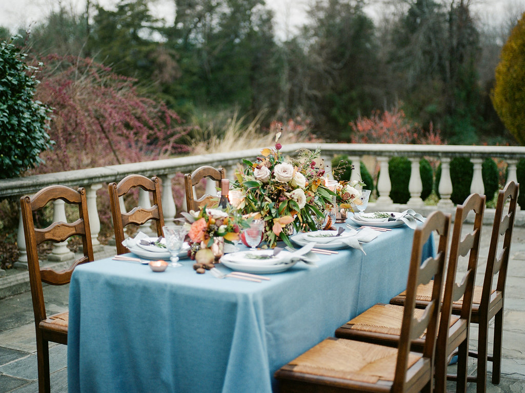 wedding tables with blue tablecloths - photo by Lissa Ryan Photography https://ruffledblog.com/modern-romantic-wedding-ideas-with-family-heirlooms