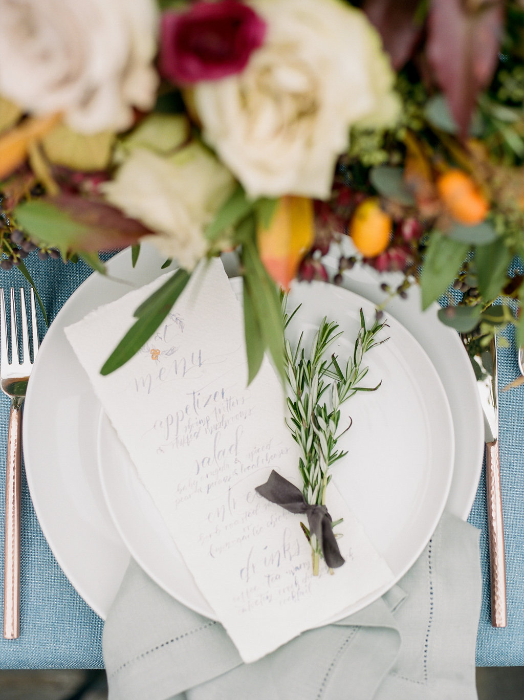 place settings with rosemary - photo by Lissa Ryan Photography https://ruffledblog.com/modern-romantic-wedding-ideas-with-family-heirlooms