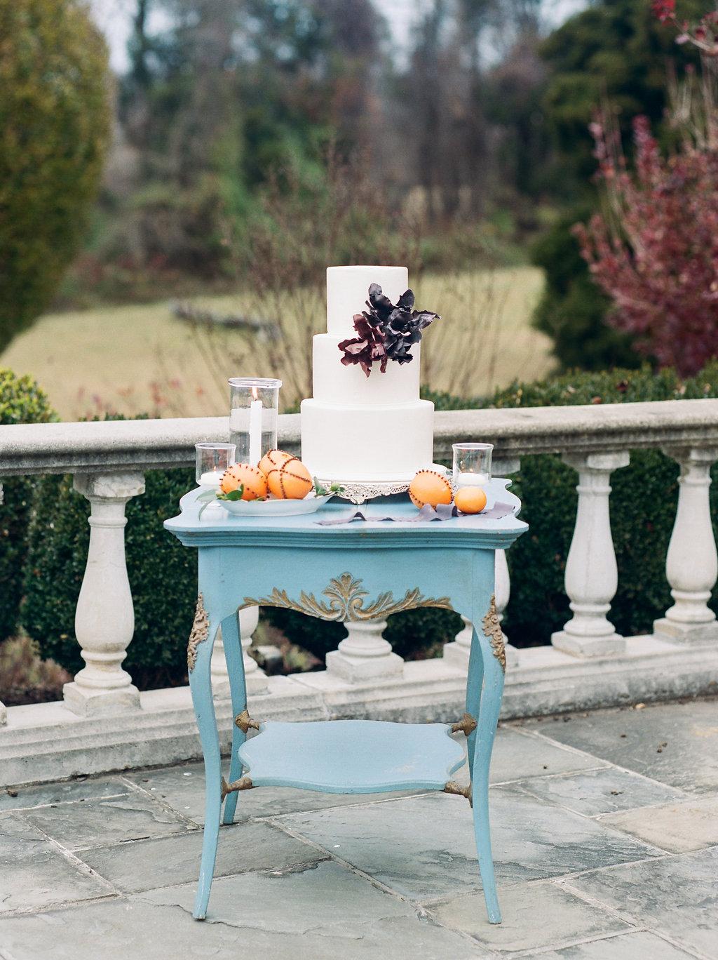 wedding cake tables - photo by Lissa Ryan Photography http://ruffledblog.com/modern-romantic-wedding-ideas-with-family-heirlooms