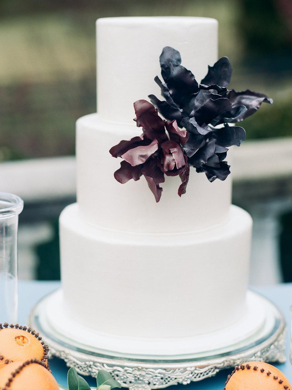 wedding cakes with sugar flowers - photo by Lissa Ryan Photography http://ruffledblog.com/modern-romantic-wedding-ideas-with-family-heirlooms