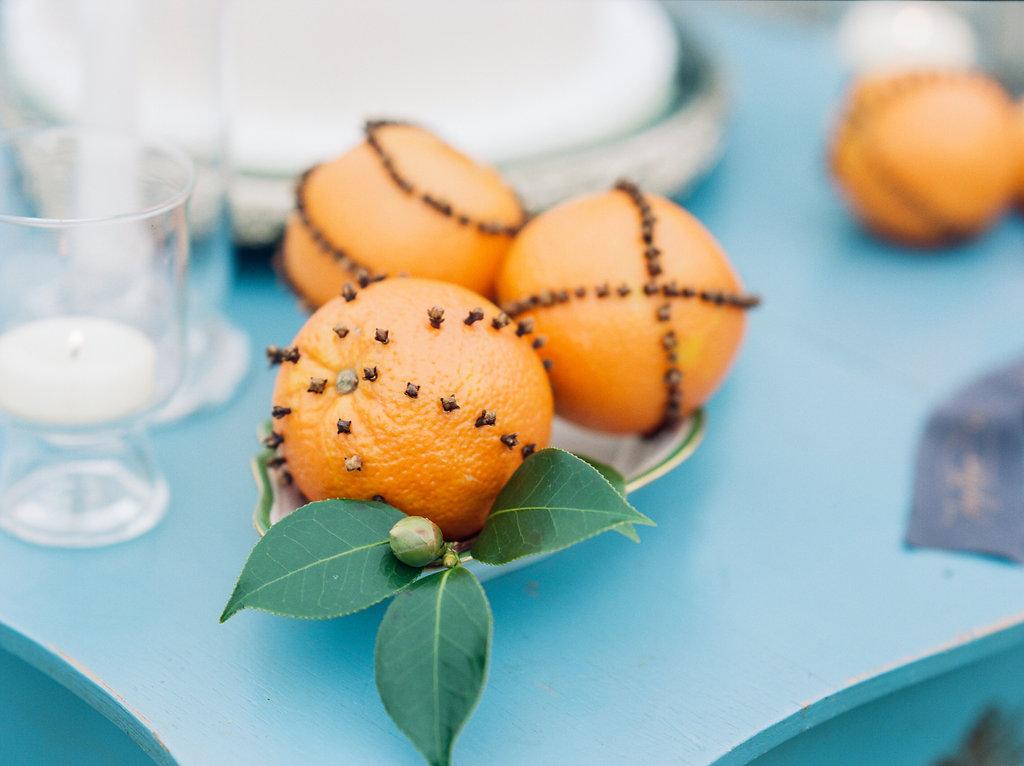 orange pomanders - photo by Lissa Ryan Photography http://ruffledblog.com/modern-romantic-wedding-ideas-with-family-heirlooms
