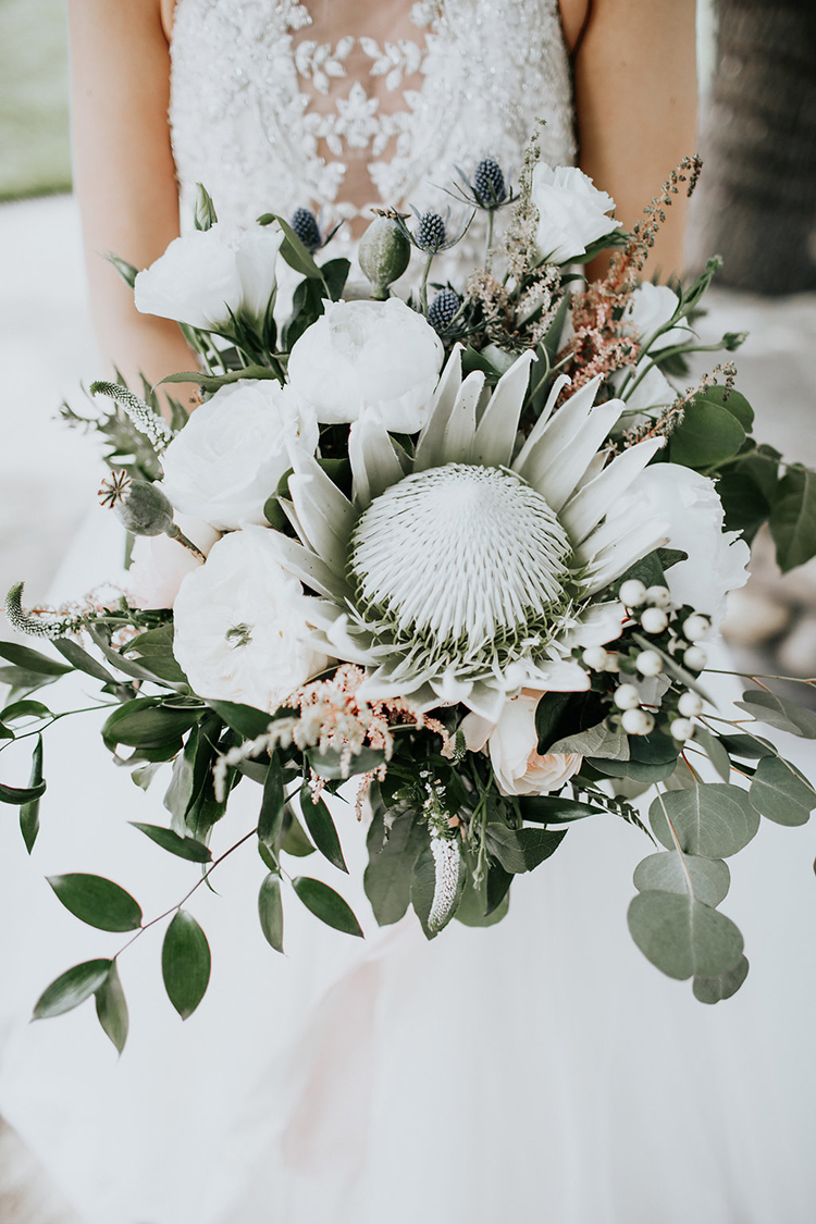 king protea bouquets - photo by Alex Lasota Photography https://ruffledblog.com/modern-rustic-winery-wedding-at-basel-cellars