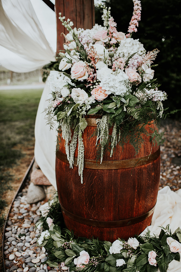 ceremony floral decor - photo by Alex Lasota Photography http://ruffledblog.com/modern-rustic-winery-wedding-at-basel-cellars