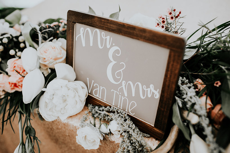 wedding table signs - photo by Alex Lasota Photography http://ruffledblog.com/modern-rustic-winery-wedding-at-basel-cellars