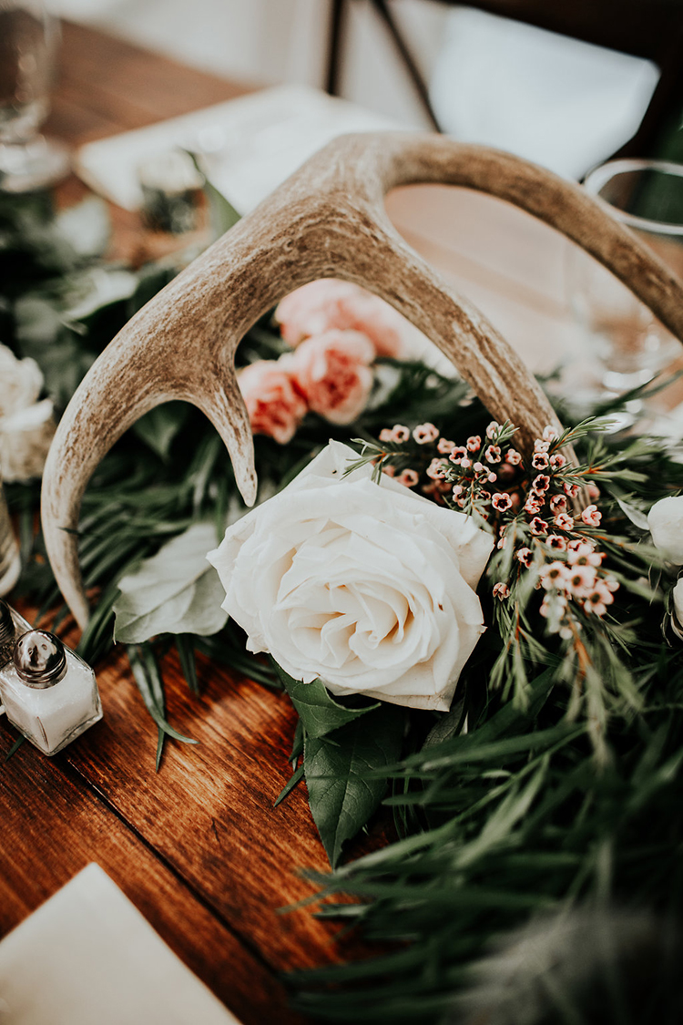 wedding decor with antlers - photo by Alex Lasota Photography http://ruffledblog.com/modern-rustic-winery-wedding-at-basel-cellars