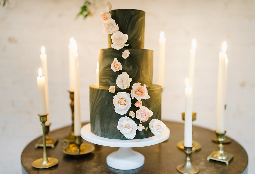 black wedding cakes with flowers - photo by Chelsea Dier Photography https://ruffledblog.com/modern-san-francisco-winery-elopement
