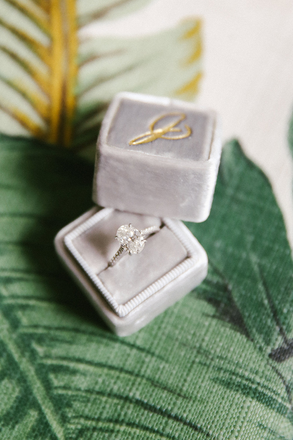 unique engagement rings - photo by W and E Photographie https://ruffledblog.com/costa-rica-destination-wedding-with-lots-of-tropical-details