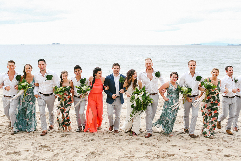beach wedding parties - photo by W and E Photographie https://ruffledblog.com/costa-rica-destination-wedding-with-lots-of-tropical-details