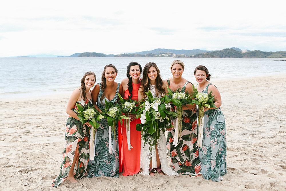 tropical bridesmaid dresses - photo by W and E Photographie http://ruffledblog.com/costa-rica-destination-wedding-with-lots-of-tropical-details
