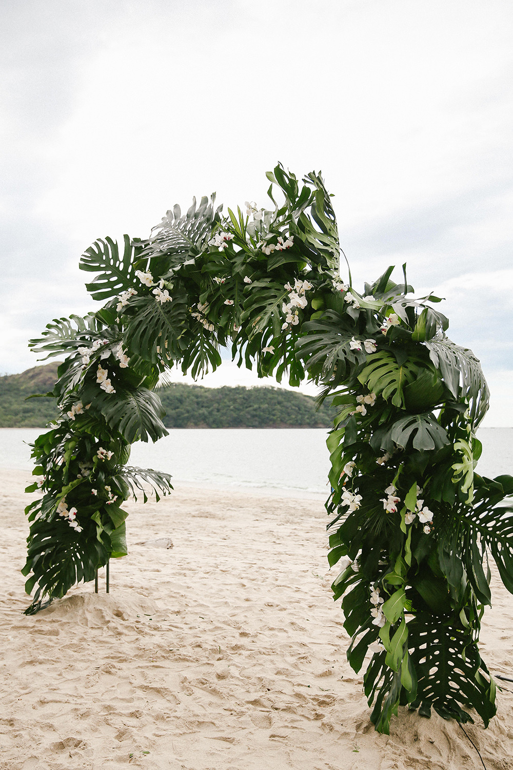 tropical wedding ceremony arches - photo by W and E Photographie https://ruffledblog.com/costa-rica-destination-wedding-with-lots-of-tropical-details