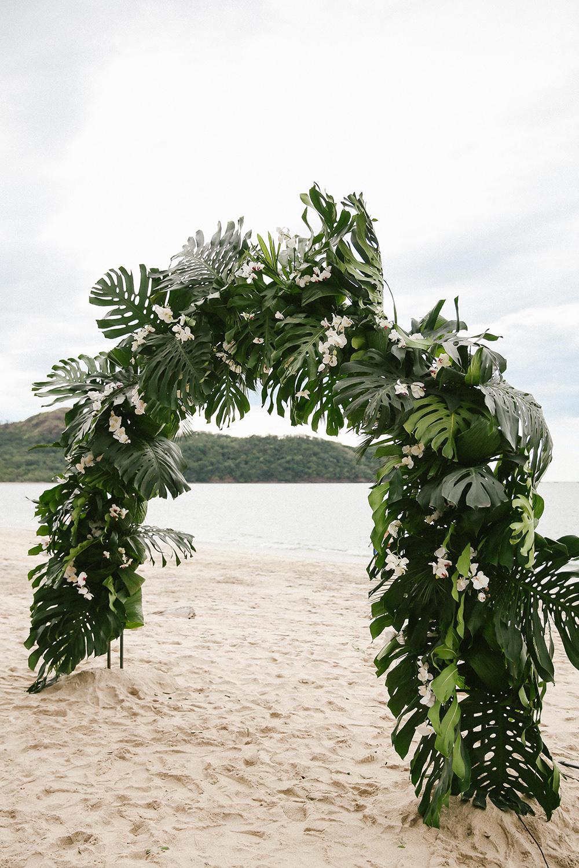 tropical wedding ceremony arches - photo by W and E Photographie http://ruffledblog.com/costa-rica-destination-wedding-with-lots-of-tropical-details