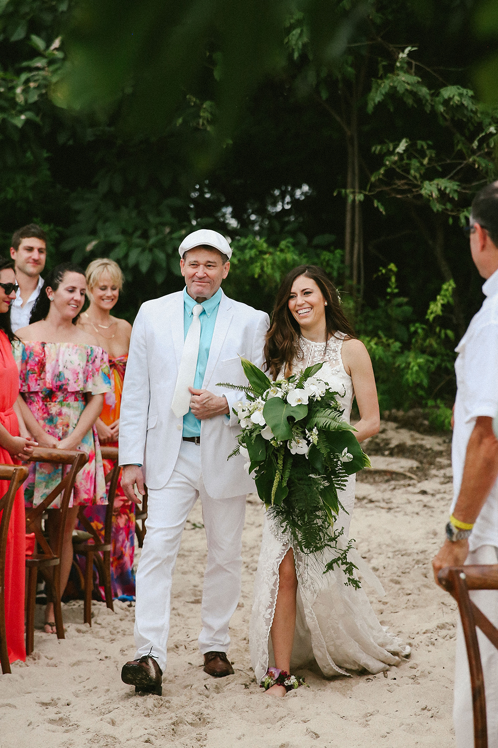 ceremony processionals - photo by W and E Photographie https://ruffledblog.com/costa-rica-destination-wedding-with-lots-of-tropical-details