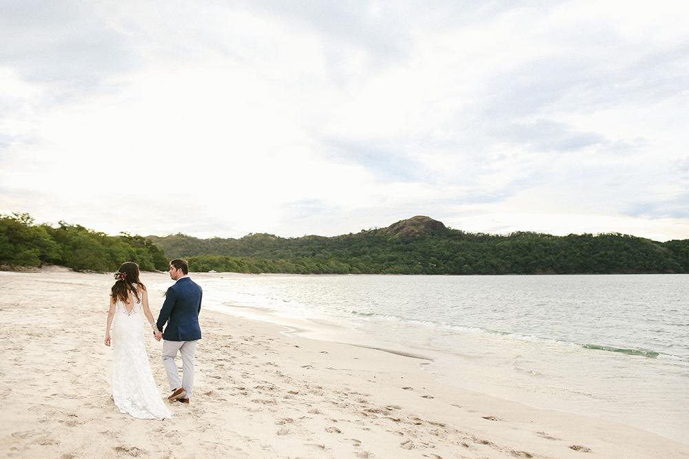 beach wedding portraits - photo by W and E Photographie http://ruffledblog.com/costa-rica-destination-wedding-with-lots-of-tropical-details