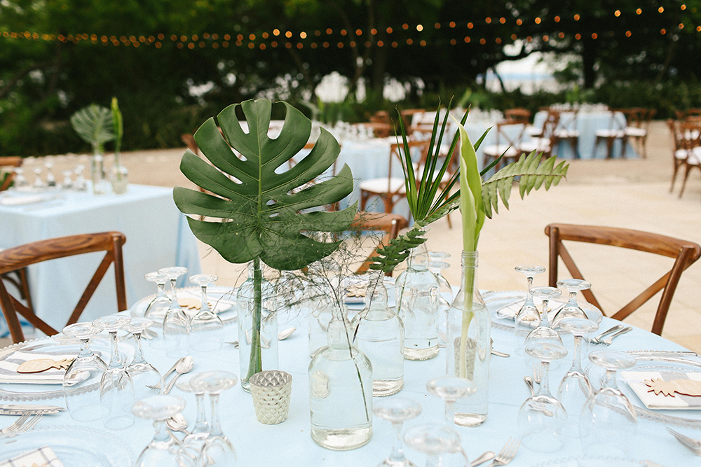 tropical simple centerpieces - photo by W and E Photographie https://ruffledblog.com/costa-rica-destination-wedding-with-lots-of-tropical-details