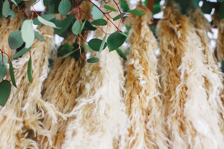 pampas grass wedding details - photo by Leigh Miller Photography https://ruffledblog.com/modern-wedding-inspiration-with-a-pampas-grass-chandelier