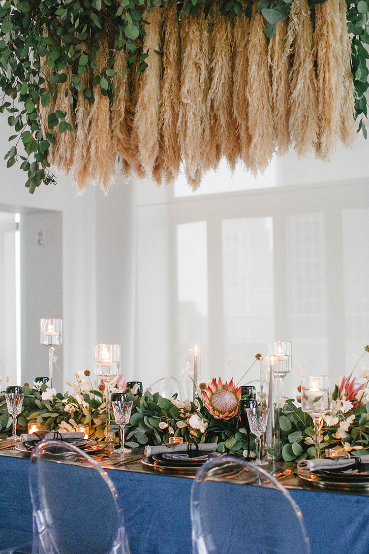 modern downtown wedding receptions - photo by Leigh Miller Photography https://ruffledblog.com/modern-wedding-inspiration-with-a-pampas-grass-chandelier