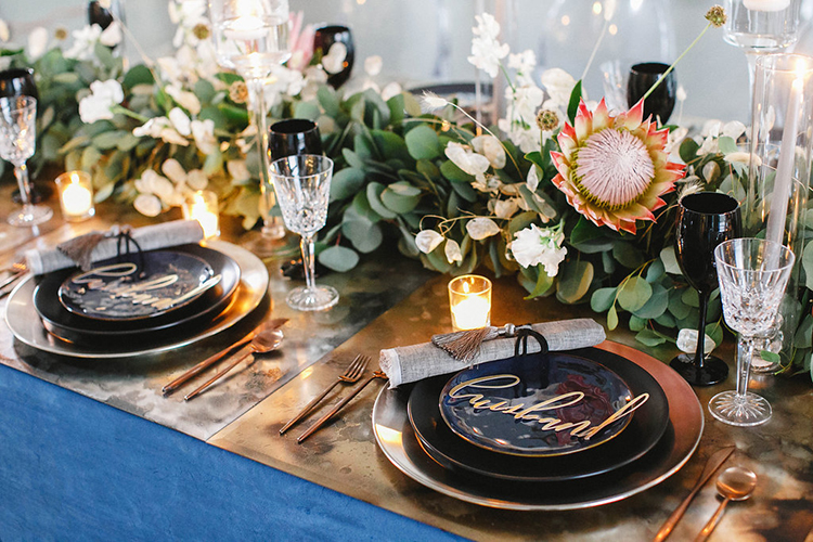 modern romantic wedding tables - photo by Leigh Miller Photography https://ruffledblog.com/modern-wedding-inspiration-with-a-pampas-grass-chandelier