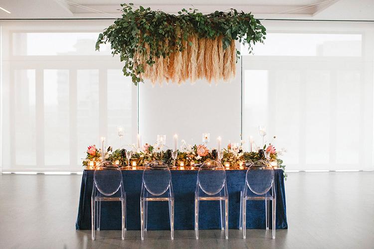 modern wedding receptions - photo by Leigh Miller Photography https://ruffledblog.com/modern-wedding-inspiration-with-a-pampas-grass-chandelier