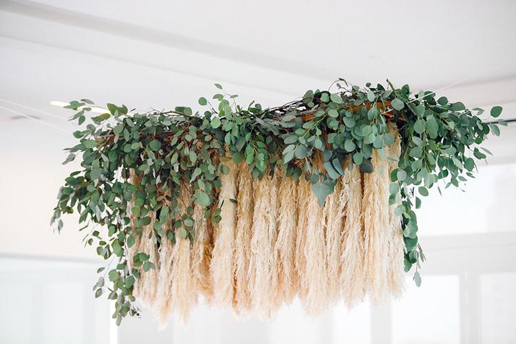 pampas grass chandeliers - photo by Leigh Miller Photography https://ruffledblog.com/modern-wedding-inspiration-with-a-pampas-grass-chandelier