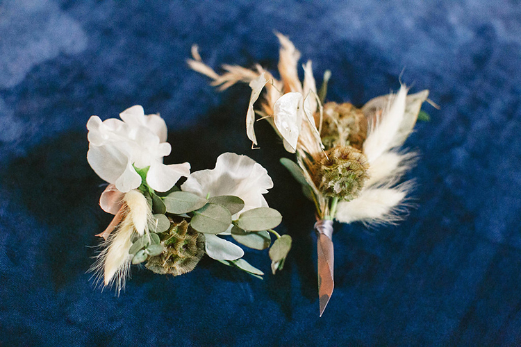 rustic groom boutonnieres - photo by Leigh Miller Photography https://ruffledblog.com/modern-wedding-inspiration-with-a-pampas-grass-chandelier
