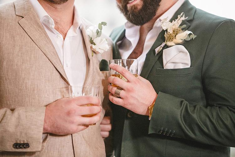 groom wedding inspiration - photo by Leigh Miller Photography https://ruffledblog.com/modern-wedding-inspiration-with-a-pampas-grass-chandelier