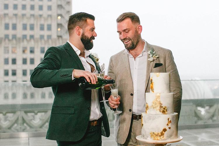 same sex wedding inspiration - photo by Leigh Miller Photography https://ruffledblog.com/modern-wedding-inspiration-with-a-pampas-grass-chandelier