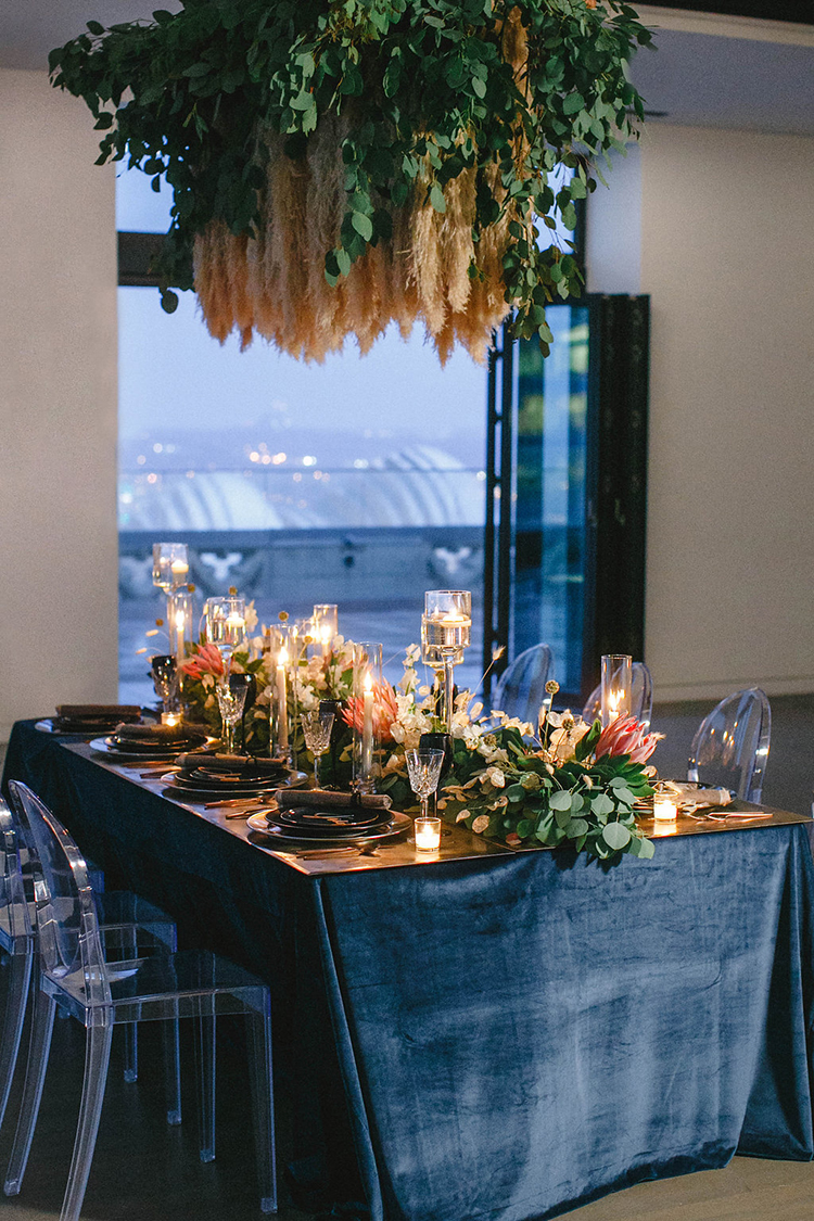 modern downtown wedding inspiration - photo by Leigh Miller Photography https://ruffledblog.com/modern-wedding-inspiration-with-a-pampas-grass-chandelier