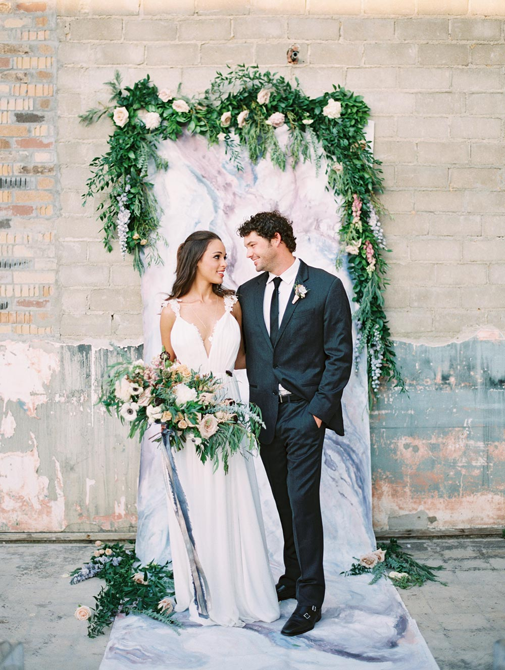 marble wedding backdrop with greenery garland