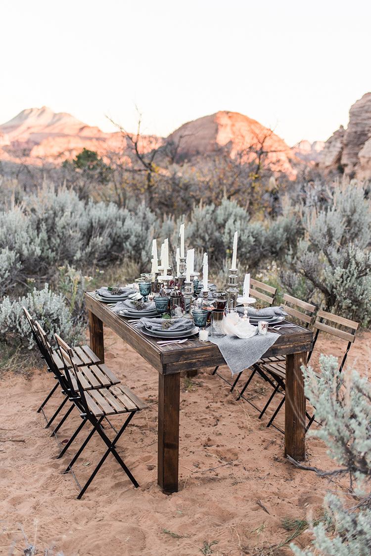 wedding reception tables - photo by Courtney Hanson Photography https://ruffledblog.com/moody-romantic-zion-national-park-wedding-ideas