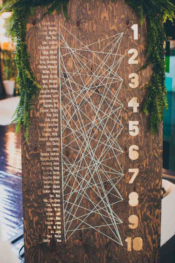 string art seating chart - photo by Mr Haack Photography https://ruffledblog.com/40-eye-catching-geometric-wedding-ideas