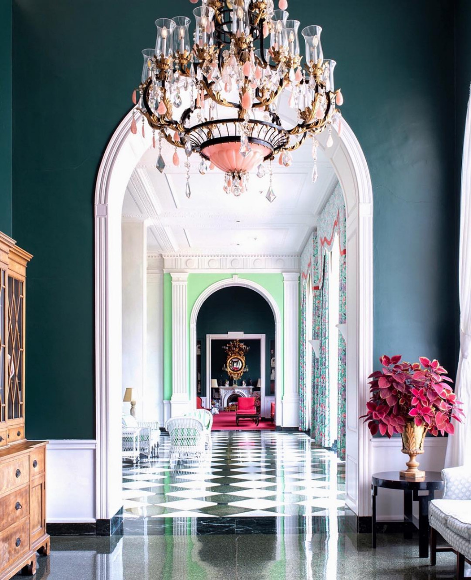 artsy hotel lobby with teal walls and checkered floors