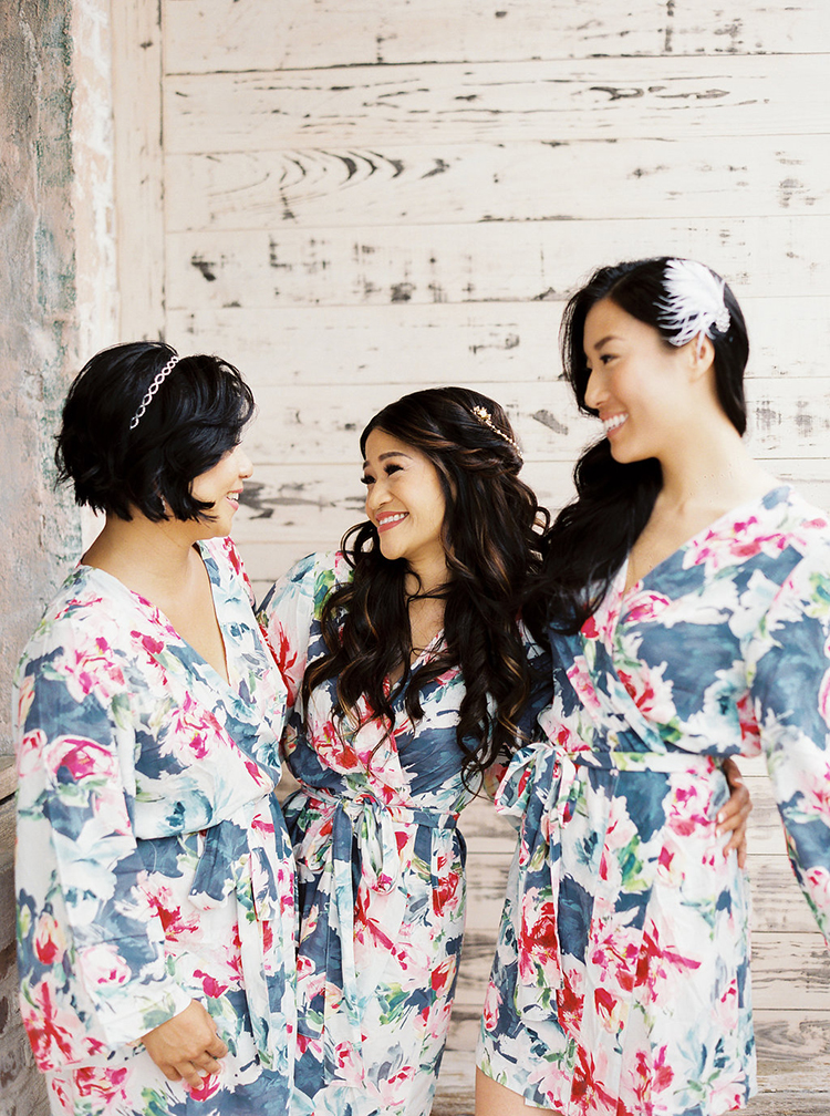 bride and bridesmaids in robes - photo by Greer Gattuso https://ruffledblog.com/new-orleans-wedding-with-the-cutest-woodland-details