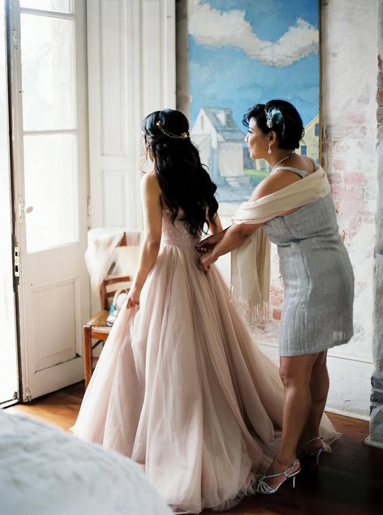 bride getting ready - photo by Greer Gattuso https://ruffledblog.com/new-orleans-wedding-with-the-cutest-woodland-details