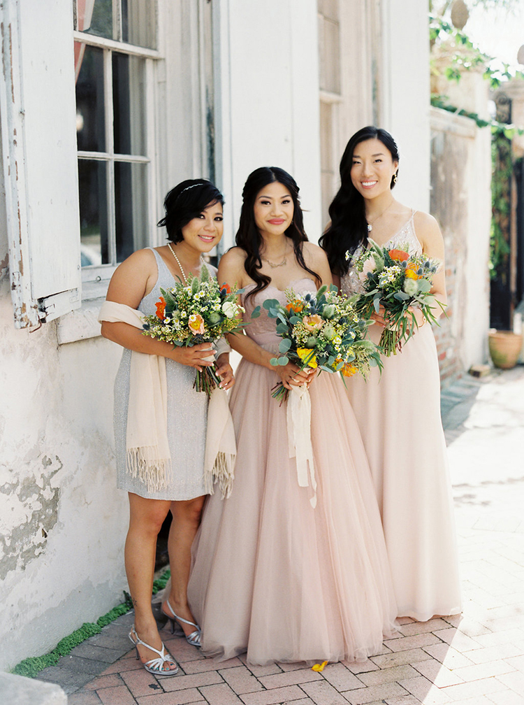 bridesmaids with summer bouquets - photo by Greer Gattuso https://ruffledblog.com/new-orleans-wedding-with-the-cutest-woodland-details
