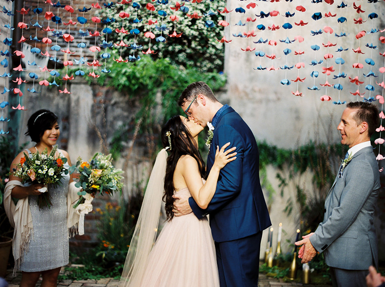 ceremony kisses - photo by Greer Gattuso https://ruffledblog.com/new-orleans-wedding-with-the-cutest-woodland-details