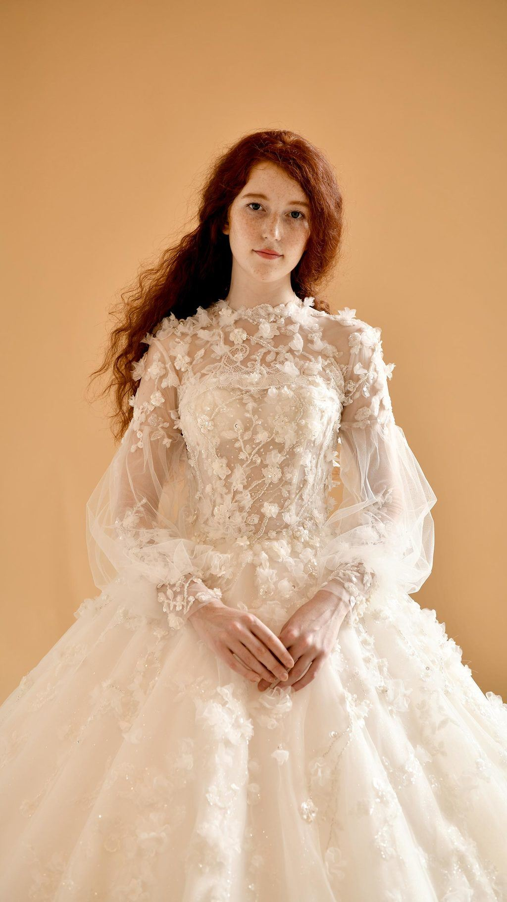 peasant sleeve wedding dress with floral appliques and a high neck