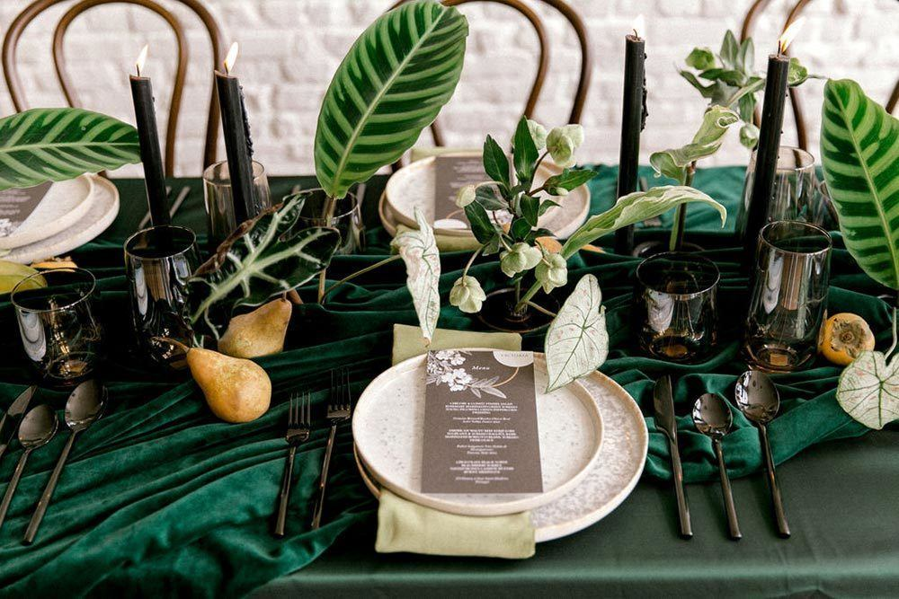 textured clay plates and vintage botanical menu with green linens and napkins