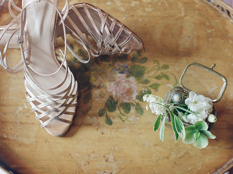 rose gold wedding shoes - photo by Julie Michaelsen Photography http://ruffledblog.com/old-world-london-wedding-inspiration-with-delicate-details