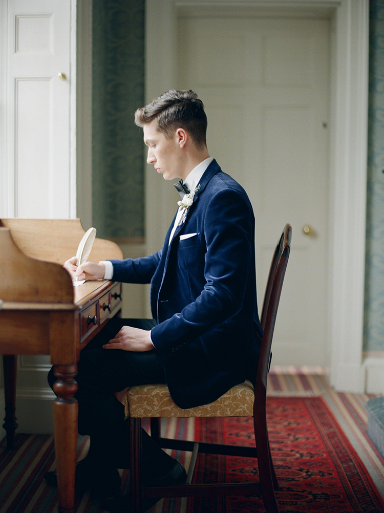 groom writing his bride a note - photo by Julie Michaelsen Photography http://ruffledblog.com/old-world-london-wedding-inspiration-with-delicate-details
