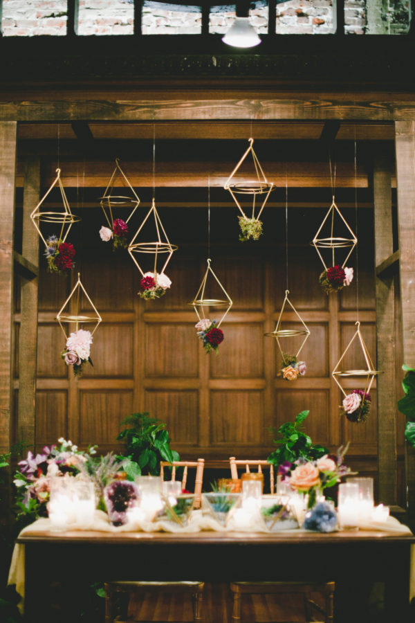 gold geo hanging lanterns - photo by Onelove Photography https://ruffledblog.com/40-eye-catching-geometric-wedding-ideas