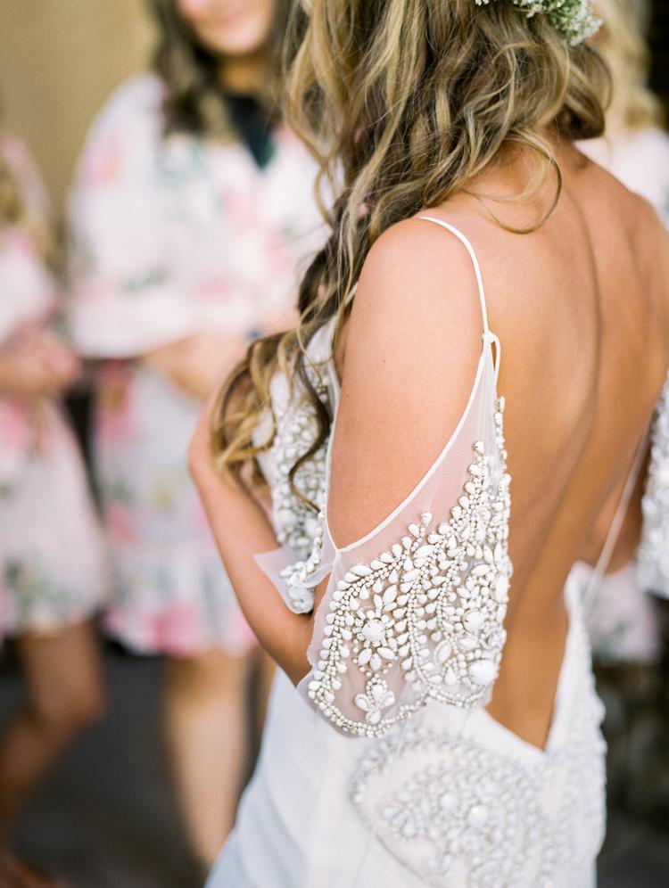 wedding dress details - photo by Gabriela Ines Photography https://ruffledblog.com/oregon-resort-wedding-with-bohemian-style