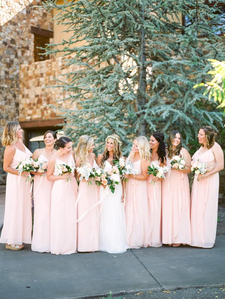 pink bridesmaid dresses - photo by Gabriela Ines Photography http://ruffledblog.com/oregon-resort-wedding-with-bohemian-style