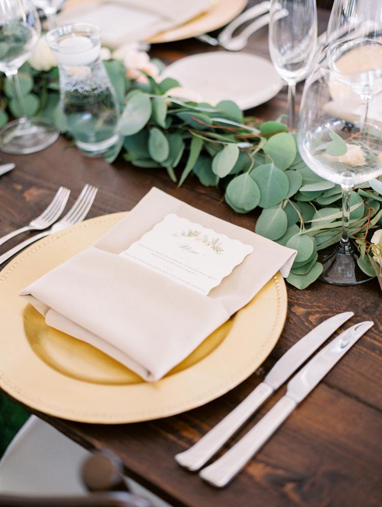 gold place settings - photo by Gabriela Ines Photography http://ruffledblog.com/oregon-resort-wedding-with-bohemian-style