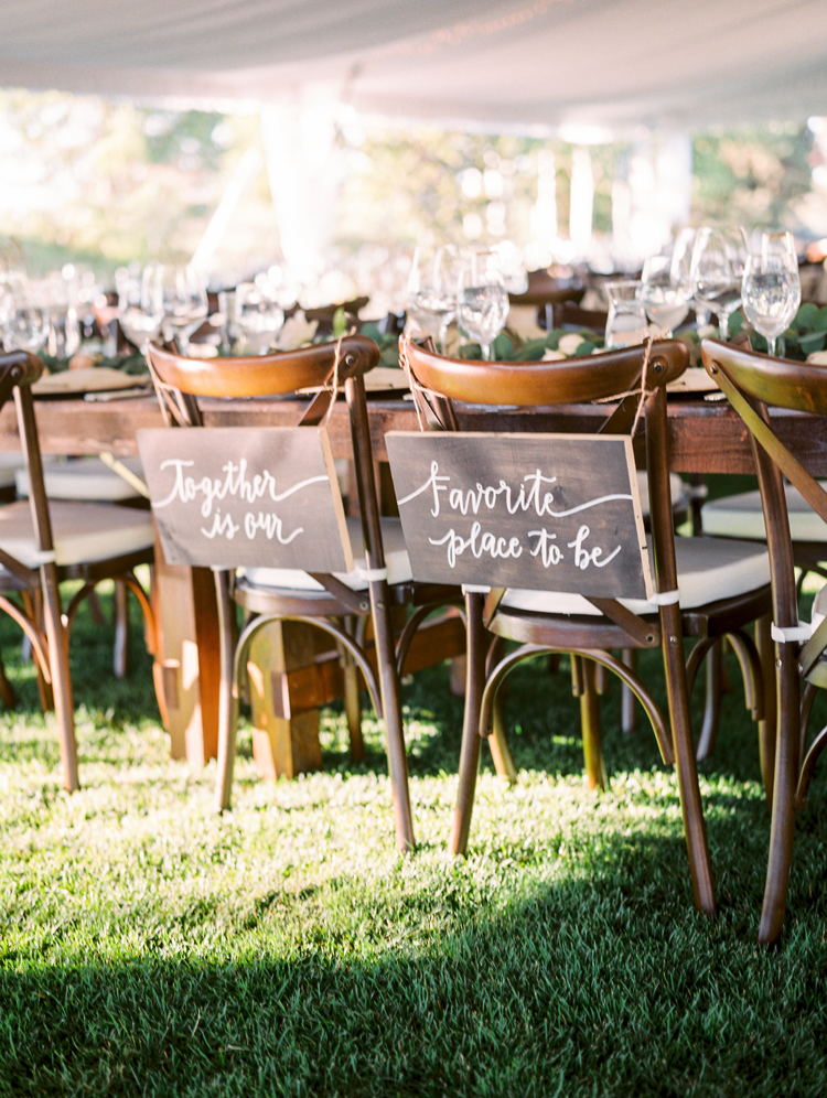 chair signs - photo by Gabriela Ines Photography https://ruffledblog.com/oregon-resort-wedding-with-bohemian-style
