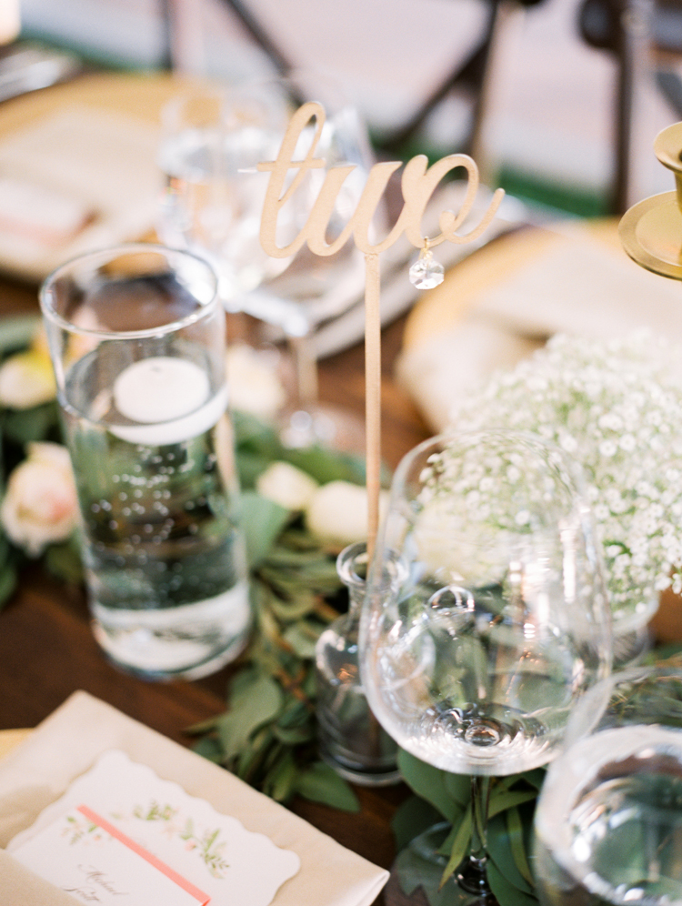gold table numbers - photo by Gabriela Ines Photography http://ruffledblog.com/oregon-resort-wedding-with-bohemian-style