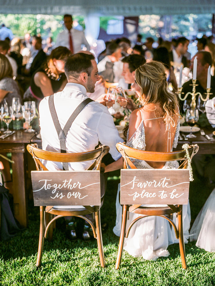 bride and groom wedding chairs - photo by Gabriela Ines Photography http://ruffledblog.com/oregon-resort-wedding-with-bohemian-style