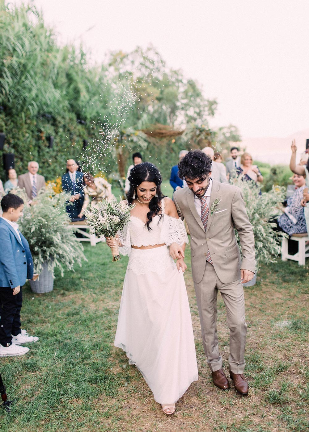 boho off-the-shoulder wedding dress and tan groom suit destination wedding