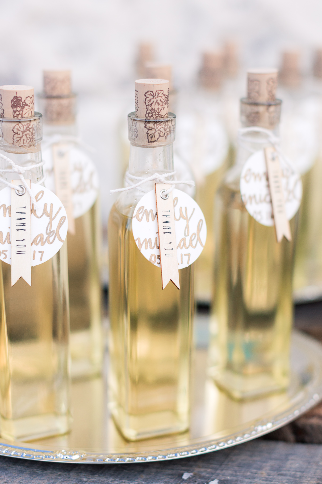 olive oil wedding favors - photo by B.Matthews Creative https://ruffledblog.com/organic-italian-inspired-wedding-ideas