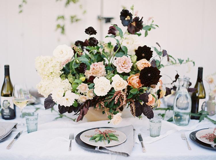 wedding centerpieces - photo by Kara Miller https://ruffledblog.com/organic-romantic-wedding-inspiration
