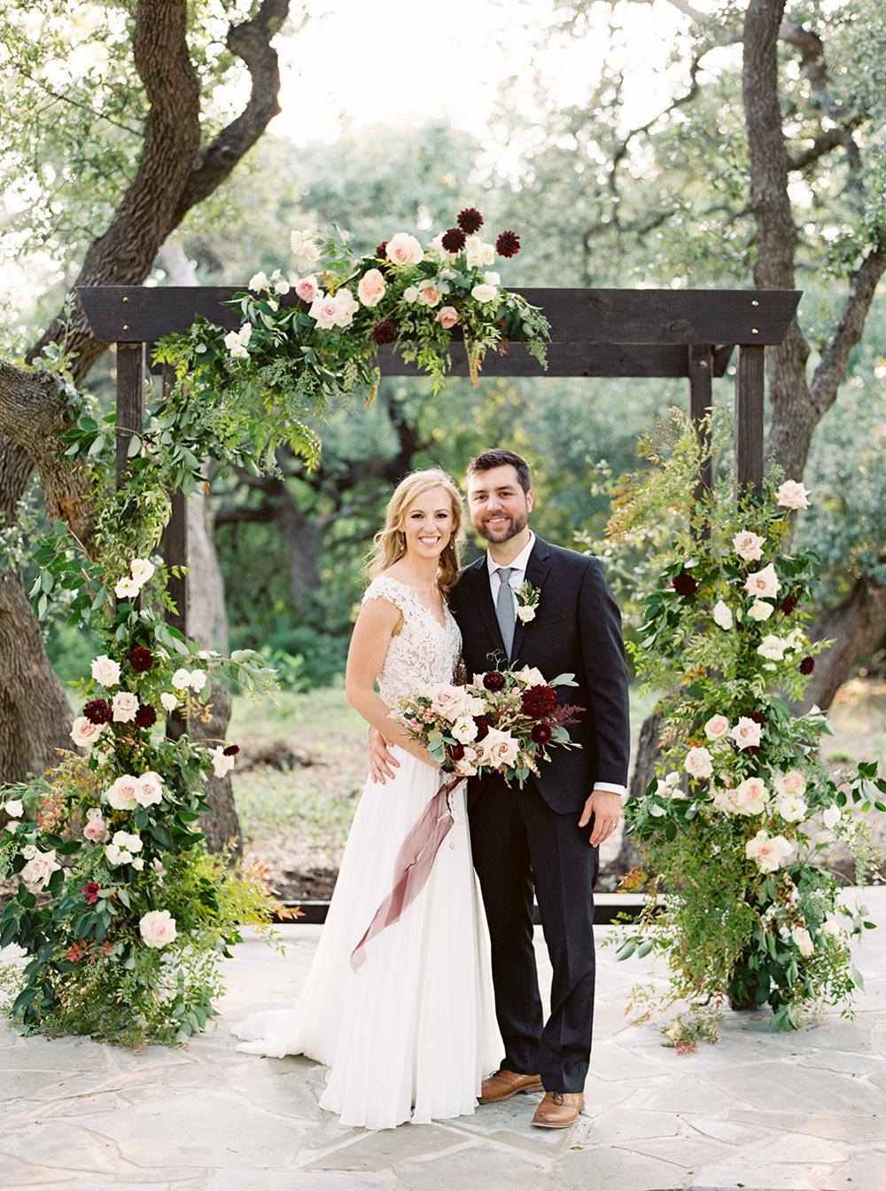 climbing flowers outdoor wedding ceremony arbor